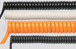 PVC spiral cables: Low mechanical and chemical load rating, medium retraction force. PUR spiral cables: The optimal solution in most areas of application. Chemically, mechanically, thermally and optically (different colors) excellent. Very good retraction force. Hi-Tech Controls, European